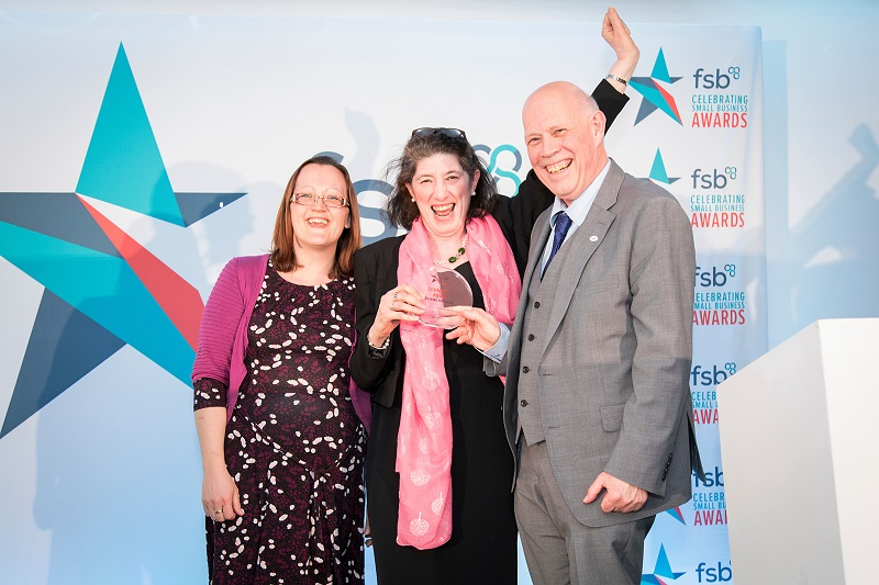 Sharing Parenting's Outreach Worker, Amba Keeble and Director, Suzanne Pearson receiving the FSB Community Award at Newmarket Racecourse.